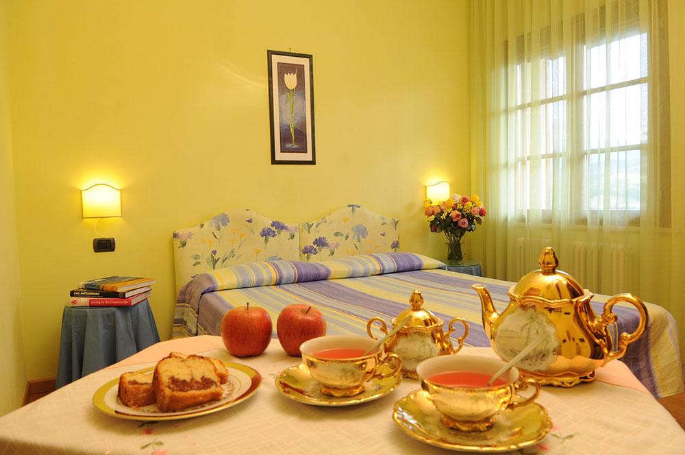Camera matrimoniale doppia con letti singoli